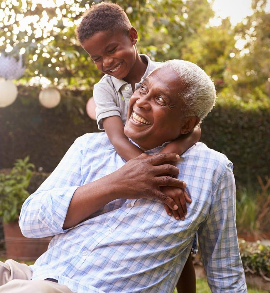 Grandfather playing outside with grandson