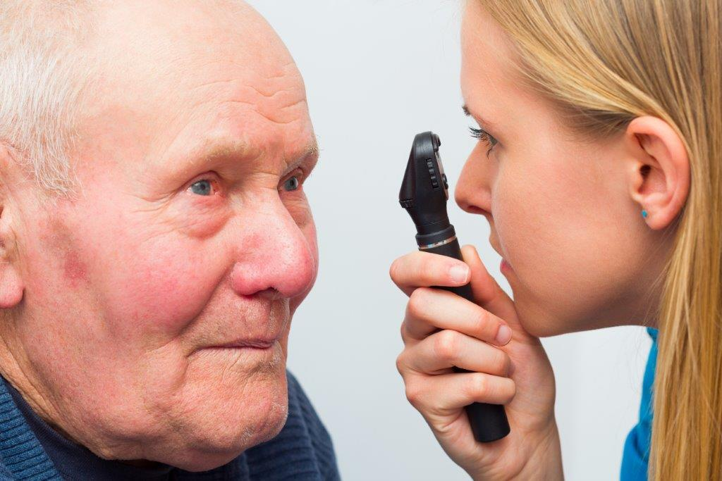 Older man having his eyes examined