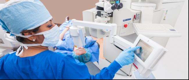 Surgeon performing eye surgery