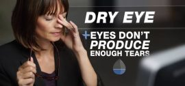 Woman rubbing her irritated eyes