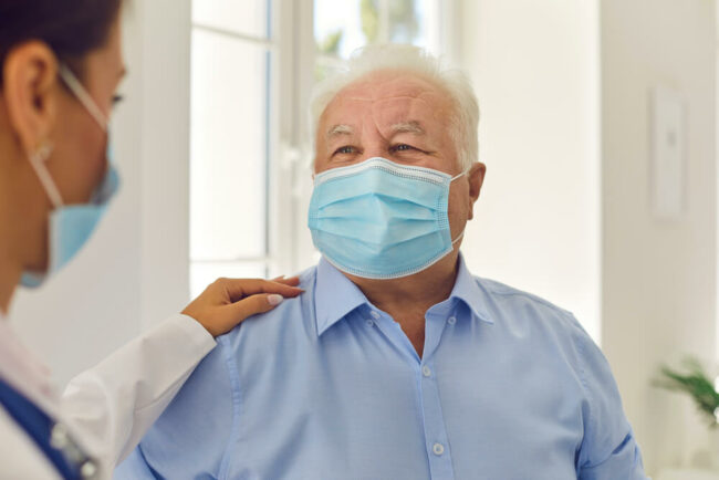 Patient and doctor wearing masks