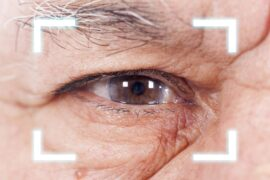 Close-up of Old Man's eye. High Technologies in the future