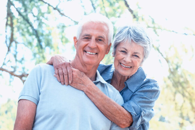 senior couple smiling in the park