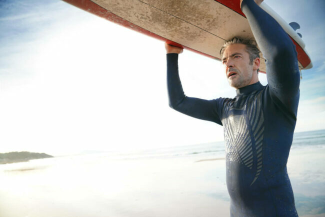 middle-aged man with surfboard